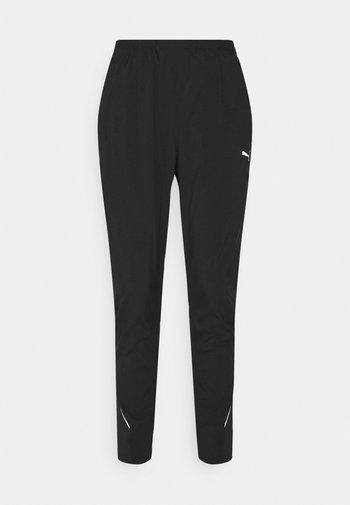 RUN TAPERED PANT - Pantalones deportivos - black