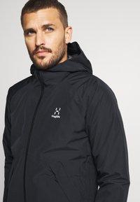 Haglöfs - SKUTA JACKET MEN - Hardshell jacket - true black - 3
