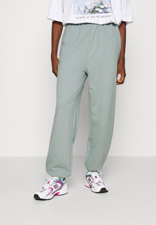 Loose fit tracksuit bottoms - Teplákové kalhoty - light blue
