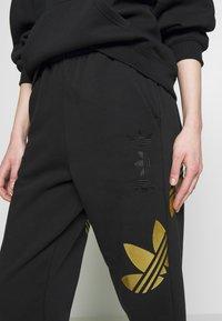 adidas Originals - LARGE LOGO PANT - Tracksuit bottoms - black/gold - 3