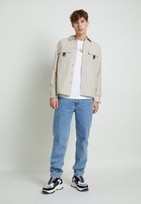 Calvin Klein Jeans - BACK GRAPHIC UNISEX - Maglietta a manica lunga - bright white - 2