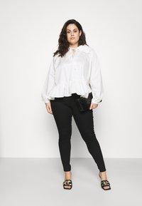 Vero Moda Curve - VMLUDY - Jeans Skinny Fit - black - 1