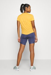 Nike Performance - MILER - T-shirt print - topaz gold/reflective silver - 2