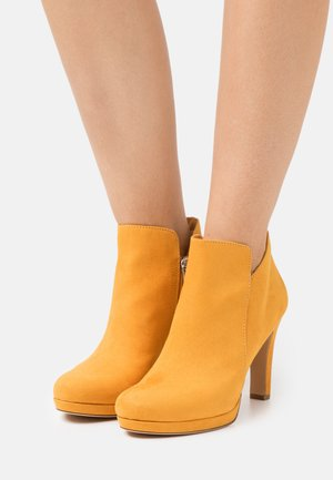 High heeled ankle boots - mango