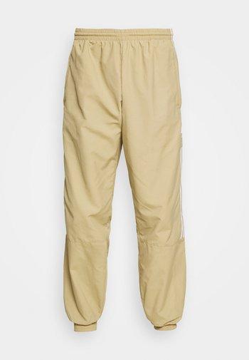 LOCK UP UNISEX - Pantaloni sportivi - beige tone