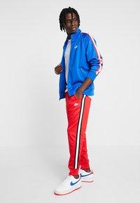 Nike Sportswear - Tracksuit bottoms - university red - 1