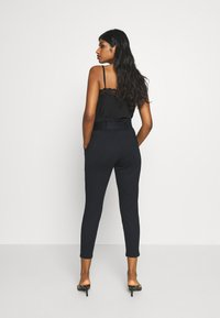 Vero Moda Petite - VMBAILEY PAPERBAG BELT PANTS - Trousers - black - 2