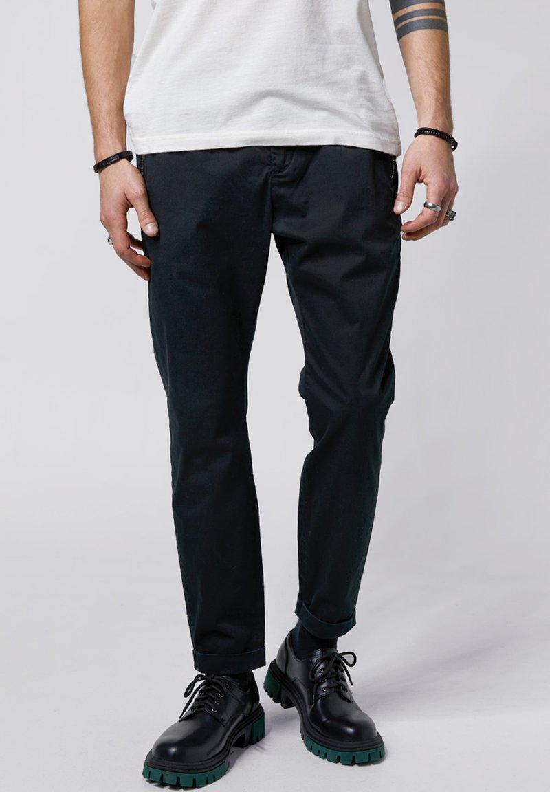 Tigha - Trousers - vintage black
