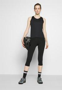 Ziener - NABIR X-GEL - 3/4 sportovní kalhoty - black - 1
