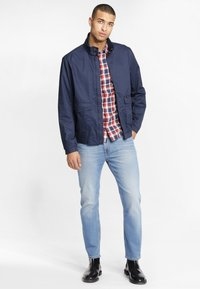 Lee - RIDER CROPPED - Jeansy Slim Fit - mottled light blue - 1