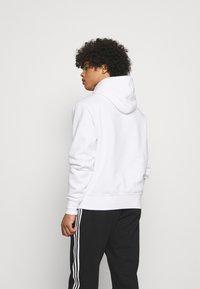 adidas Originals - HOODY UNISEX - Sweatshirt - white - 2