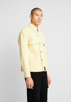 LANCE - Denim jacket - yellow sand
