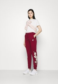 SIKSILK - FLORAL EMBROIDERED JOGGERS - Tracksuit bottoms - burgundy - 1