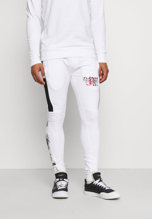 FIRE - Trainingsbroek - white