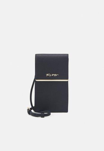 MODERN PHONE BAG - Phone case - blue