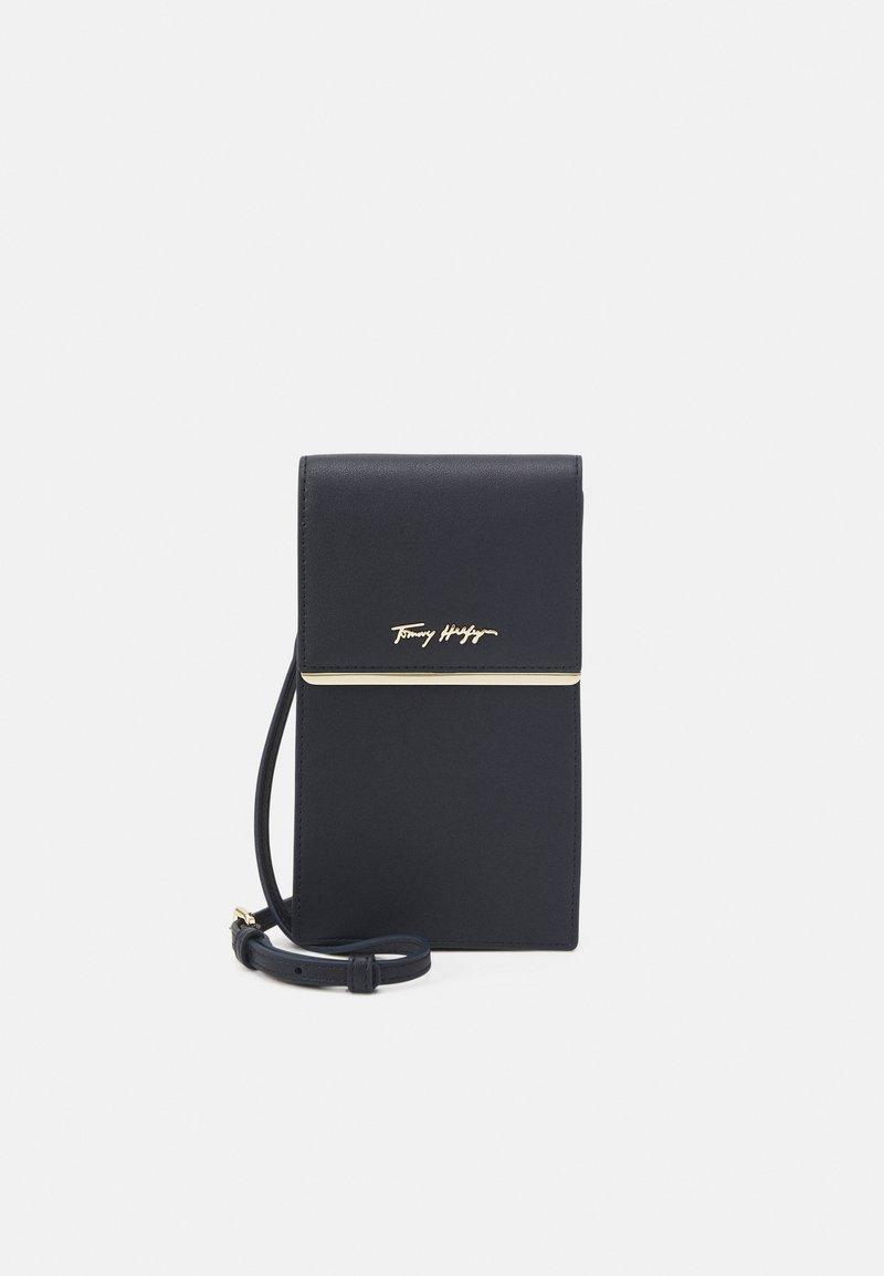 Tommy Hilfiger - MODERN PHONE BAG - Phone case - blue
