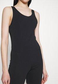 Nike Sportswear - ONE PIECE - Tuta jumpsuit - black/dark smoke grey - 3