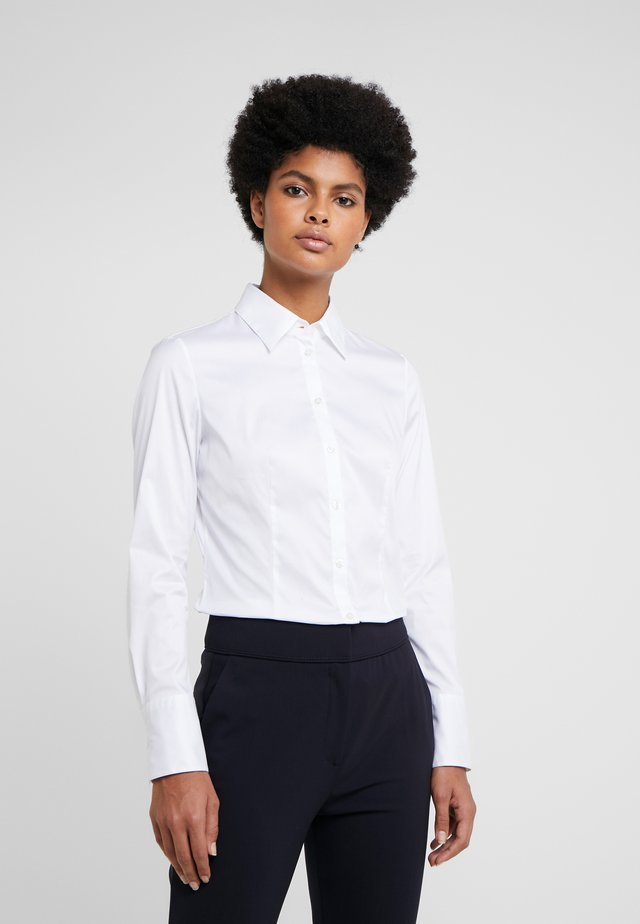 THE FITTED - Button-down blouse - white