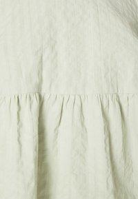 Monki - MARIA PEPLUM BLOUSE - Long sleeved top - green dusty light - 4