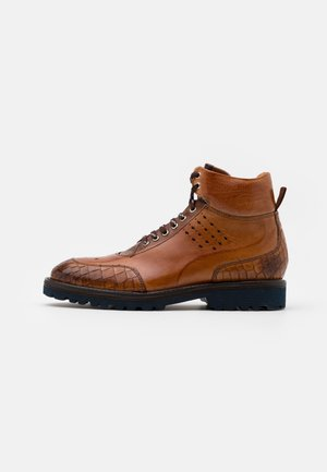 TREVOR  - Lace-up ankle boots - cognac