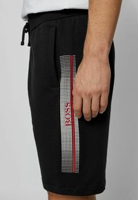 BOSS - AUTHENTIC - Tracksuit bottoms - black - 3