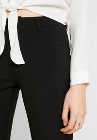 Moves - SASSY - Trousers - black - 5