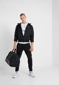 EA7 Emporio Armani - JACKET - Summer jacket - black - 1