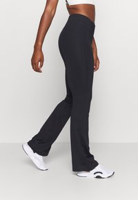 Casall - CLASSIC JAZZ PANTS - Tracksuit bottoms - black - 3