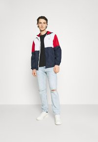 Tommy Jeans - COLORBLOCK UNISEX - Summer jacket - white/multi - 1