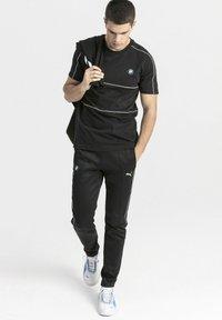 Puma - T-shirt med print - black - 1