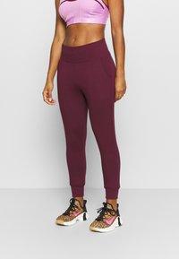 Nike Performance - FLOW HYPER 7/8 PANT - Tracksuit bottoms - night maroon - 0