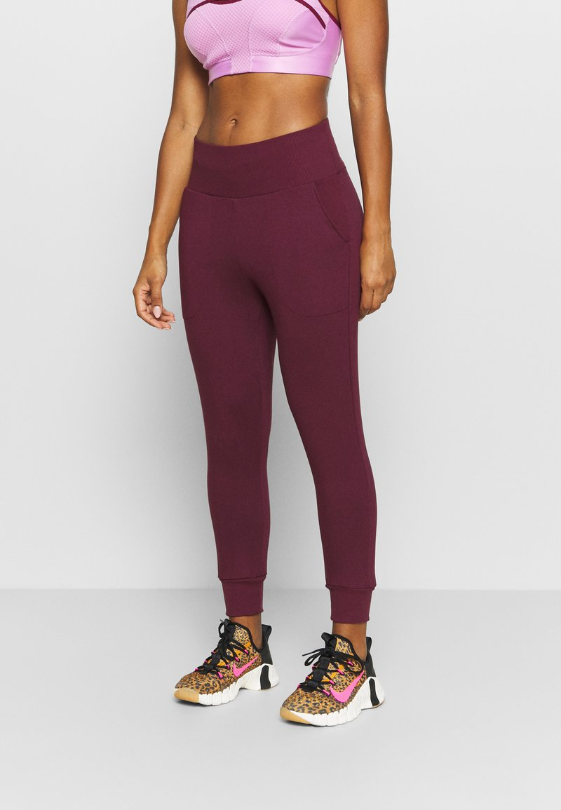 Nike Performance - FLOW HYPER 7/8 PANT - Tracksuit bottoms - night maroon