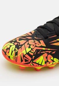 adidas Performance - NEMEZIZ MESSI .4 FXG UNISEX - Moulded stud football boots - solar red/solar yellow/core black - 5