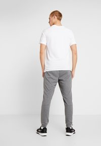 Nike Performance - DRY PANT TAPER - Træningsbukser - charcoal heathr/black