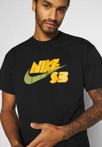 Nike SB - TEE LOGO UNISEX - Print T-shirt - black - 4
