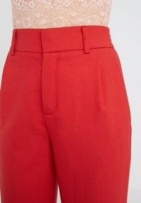 DRYKORN - FIND - Trousers - red