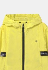 Calvin Klein Jeans - LOGO TAPE UNISEX - Light jacket - yellow - 2