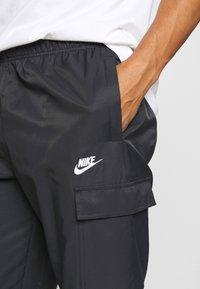 Nike Sportswear - Träningsbyxor - black/white - 4