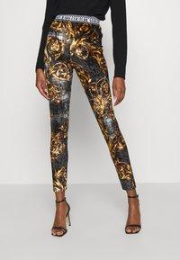 Versace Jeans Couture - PANTS - Legginsy - black/gold - 0