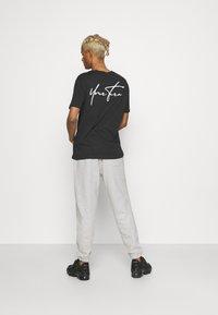 YOURTURN - UNISEX - Pantaloni sportivi - mottled light grey - 2