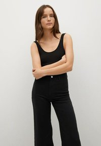 Mango - CATHERIN - Flared Jeans - black denim - 3