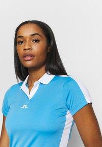 J.LINDEBERG - NOUR GOLF - Koszulka sportowa - ocean blue - 3