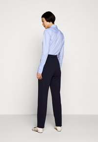 HUGO - HONESI - Trousers - open blue - 2