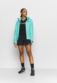 adidas Performance - TERREX PRIMEBLUE TRAIL - Sports shorts - black - 1