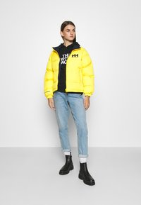 Helly Hansen - W HH  - Winter jacket - young yellow - 1