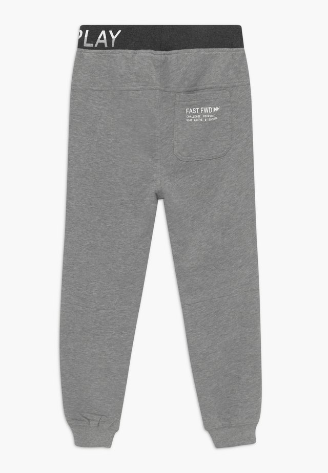 UBUD - Tracksuit bottoms - grau
