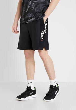 KYRIE  - Sports shorts - black/university red