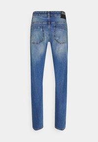 Versace Jeans Couture - DRILL - Slim fit jeans - light-blue denim - 9