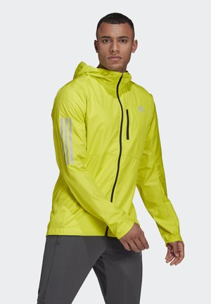 OWN THE RUN HOODED WINDBREAKER - Veste de survêtement - yellow