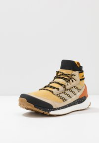 adidas Performance - FREE HIKER BOOST PRIMEKNIT SHOES - Hiking shoes - legend gold/sand/core black - 2